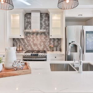 Learn the difference between Calacatta Marble Countertops vs. Carrara Marble Countertops