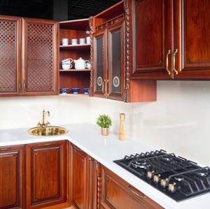 Cherry Cabinets and White Countertops