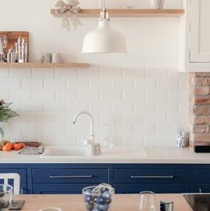 White Kitchens Featuring Blue Accents