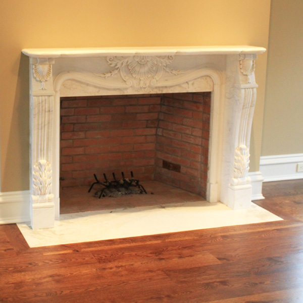 Afyon White Marble,  Engraved<br>Location: Bedford, NY<br>Project: Fireplace Surround
