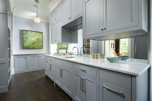 Light Gray Cabinets With White And Black Kitchen Countertops